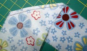 Trim seam close to stitching and press seam open